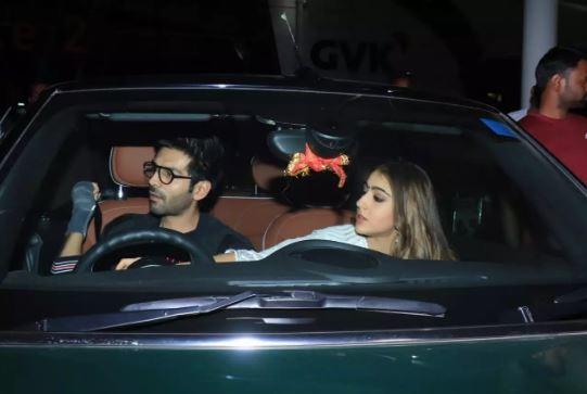 Sara Ali Khan helps an injured Kartik Aaryan wear his seat belt