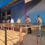 coronavirus effect People maintain distance while standing in queue to buy liquor. Viral pic