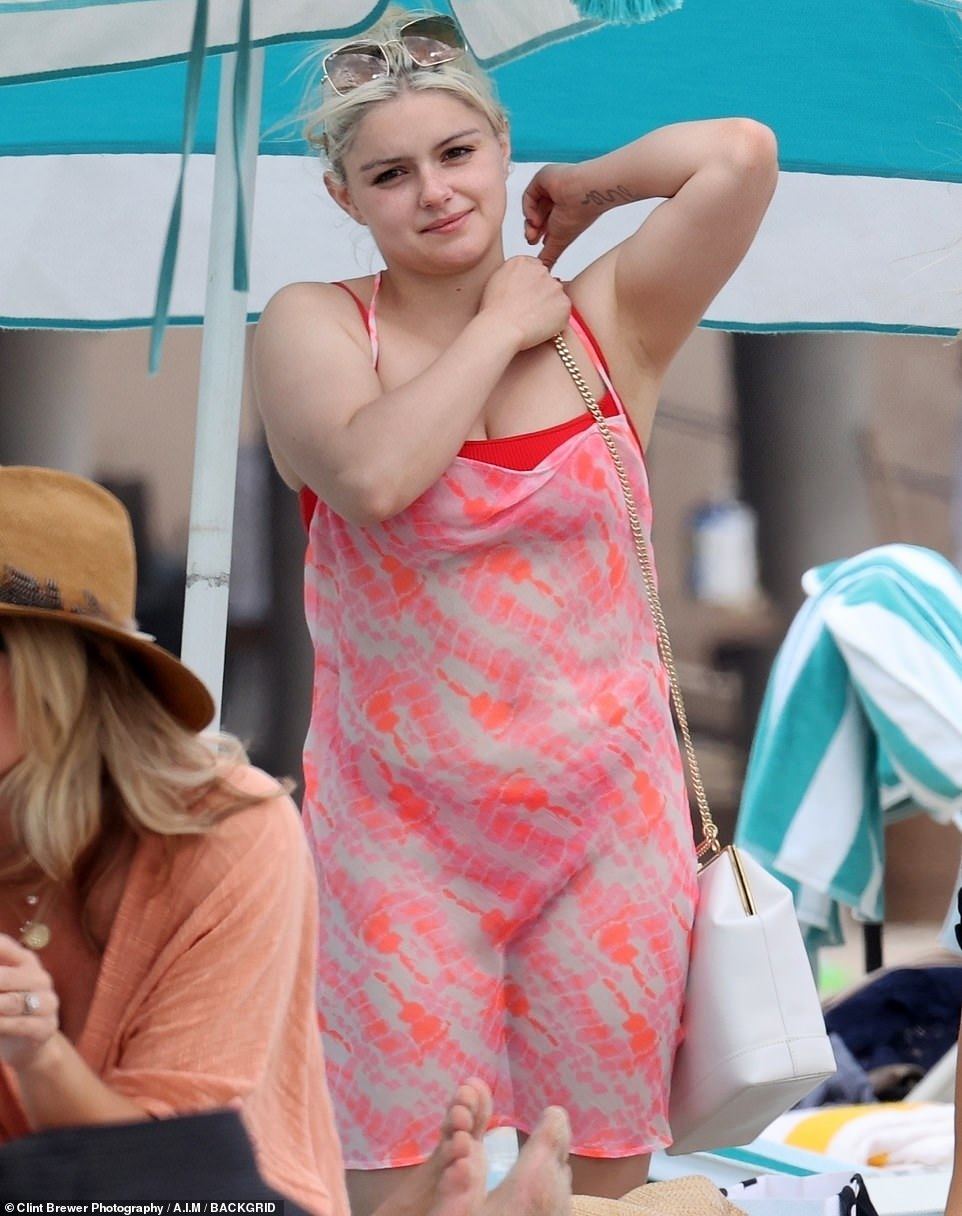 Day at the beach: Ariel Winter, 22,showed off her curvaceous figure on Sunday during a trip to the beach at Laguna Beach in California with her boyfriend Luke Benward and friends