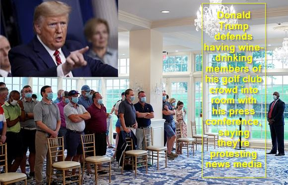 Donald Trump defends having wine-drinking members of his golf club crowd into room with his press conference, saying they're protesting news media