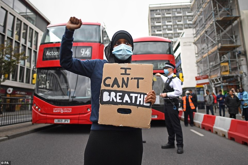 Dozens of Black Lives Matter protesters have gathered outside Notting Hill tube station in west London for a demonstration