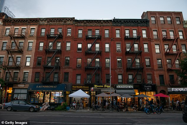 New York City residents are fleeing to the suburbs as the COVID-19 pandemic and an uptick in crime has forced those with cash to seek larger living spaces while being able to work from home. The image above shows a row of apartment buildings and restaurants in the Hell