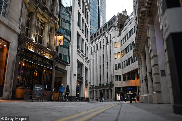 Ministers are increasingly concerned about empty town and city centres. Pictured is the City of London on August 26