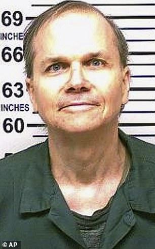 Mark David Chapman, seen in a 2018 mugshot,