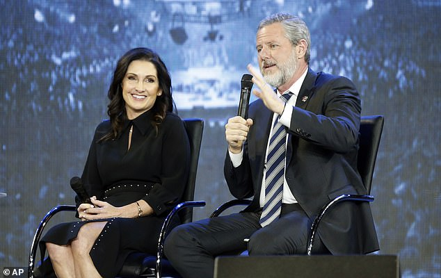 Embattled evangelical leader Jerry Falwell Jr may be owed $10.5million by Liberty University following his resignation in the wake of a sex scandal involving his wife and a Miami pool boy. Falwell pictured in November 2018 with wife Becki speaking at Liberty University