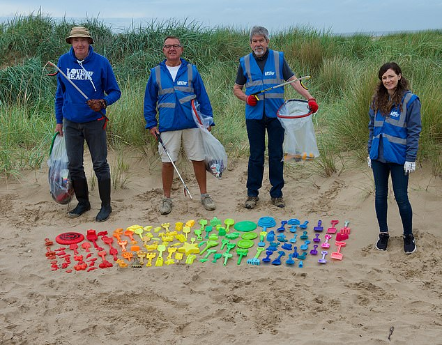 Toy story: Spades, frisbees and moulds lined up on St Annes beach near Blackpool.Volunteers say the cheap toys are increasingly being seen as one-use items to be left behind