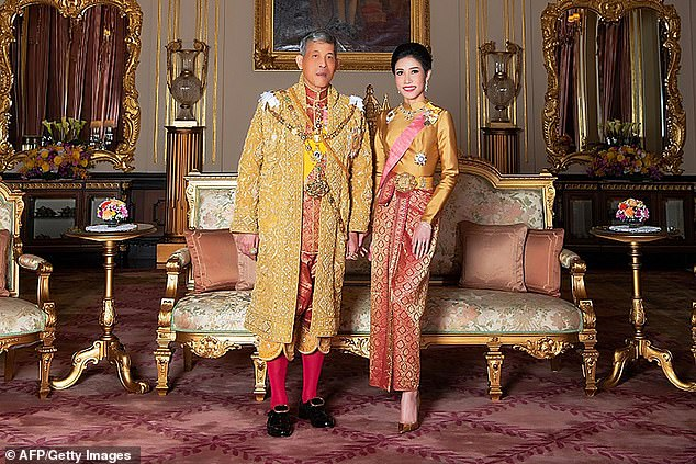 King and consort: Thai monarchMaha Vajiralongkorn appointed former royal bodyguardSineenat Wongvajirapakdi as his consort last year (pictured together in August 2019) - but she soon fell from grace and was stripped of her titles