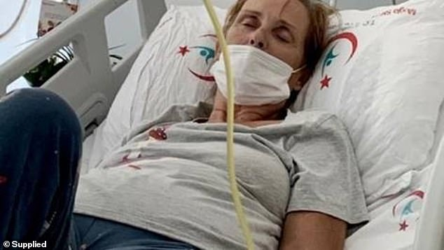 British motherCarole Fleming, 67, (pictured in hospital) is fighting for her life in a Turkish hospital after coming down with a mystery illness