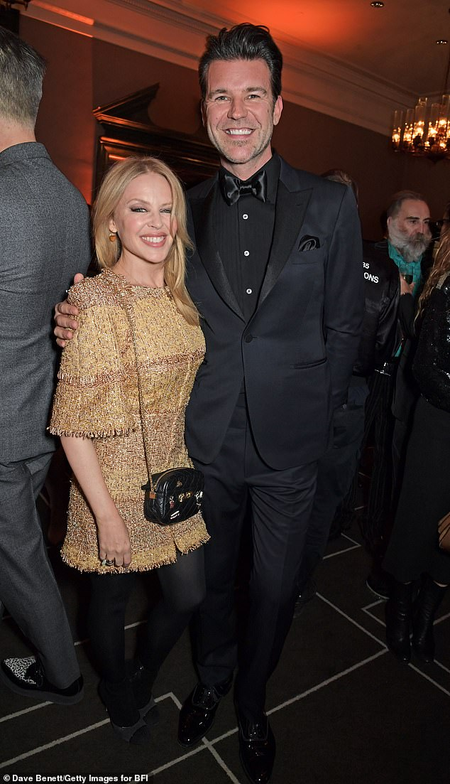 Full of praise: Kylie said that Paul 'cares about my fans, he cares about my world, but mostly he cares about me' in a gushing interview about her love (pictured together in March)
