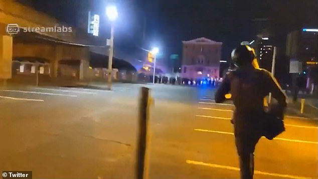 Louisville police officers are seen running for cover immediately after a shooting that injured two officers on Wednesday night