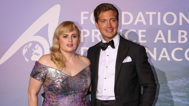 Rebel Wilson Cozies Up To Shirtless Boyfriend Jacob Busch After They Make Their Red Carpet Debut