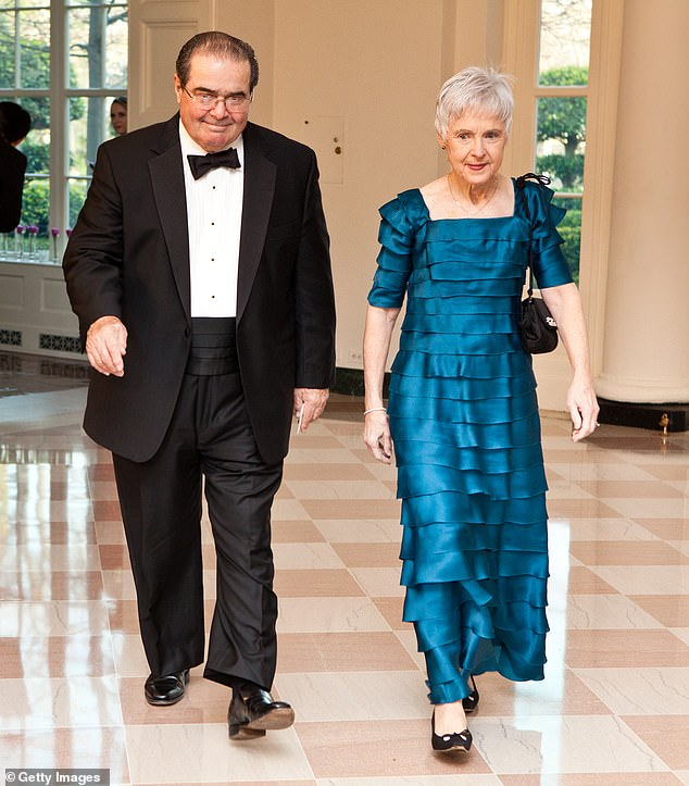 Scalia is pictured in 2012 with his wife, Maureen. Maureen was in the audience watching as Barrett was nominated to the Supreme Court