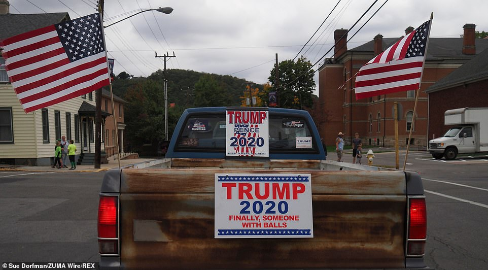 The supporters waves flags and had signs showing their support for Trump on their trucks