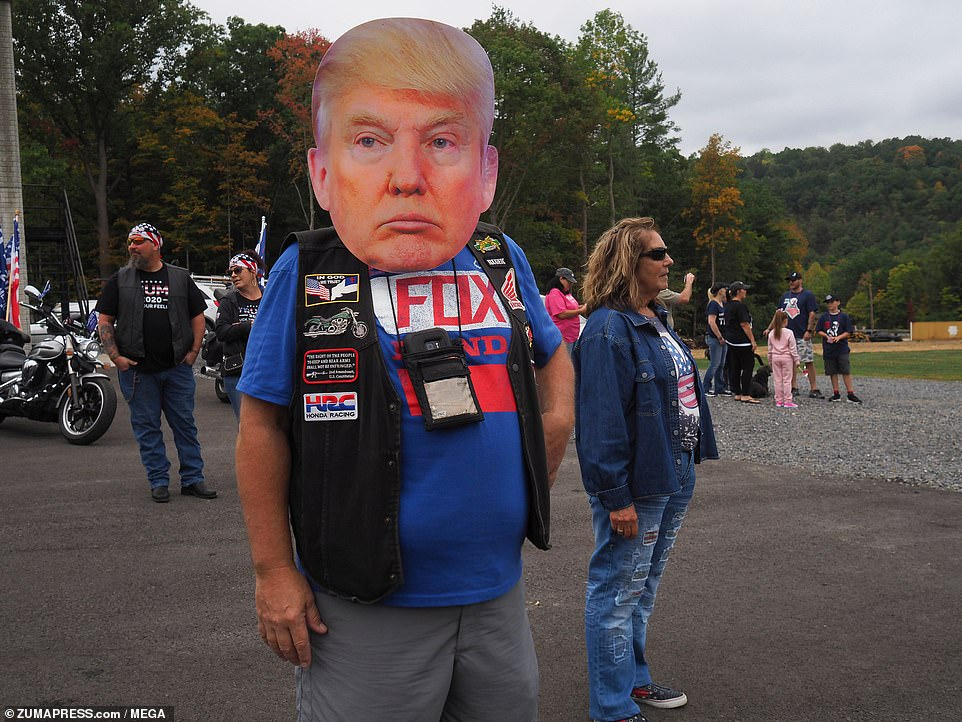 One supporters showed his love of Trump by wearing a huge face mask of the president
