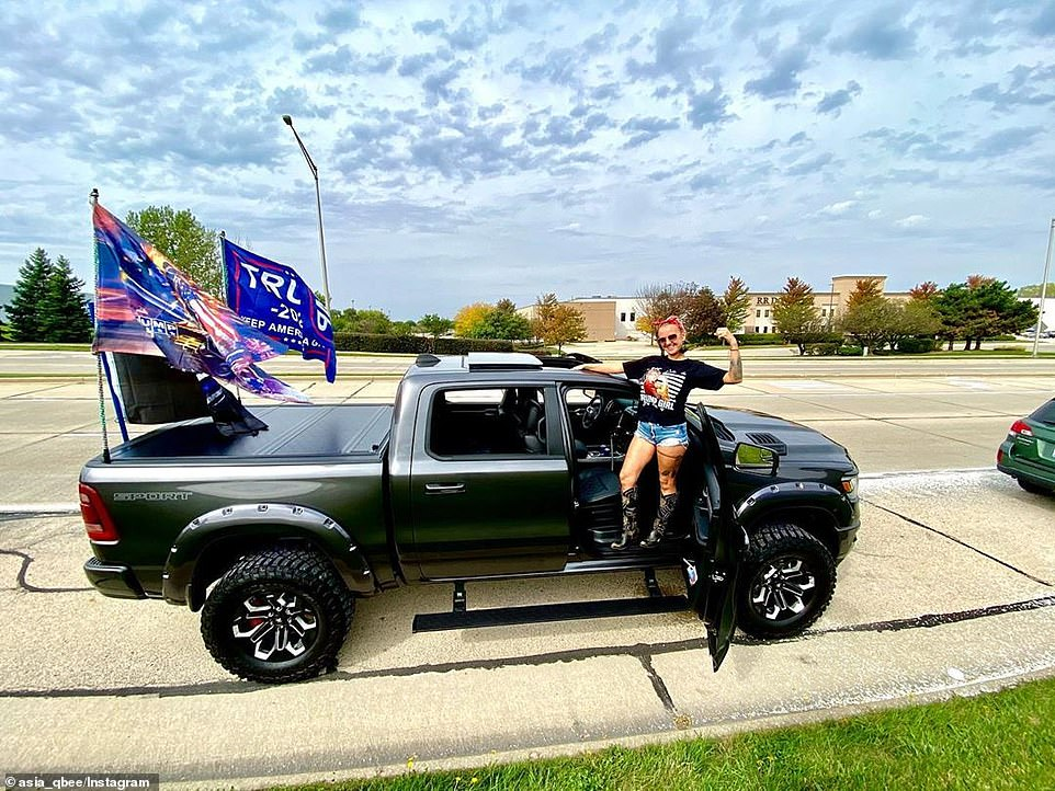 One women showed off her love of the president from her pickup truck together with Trump flags