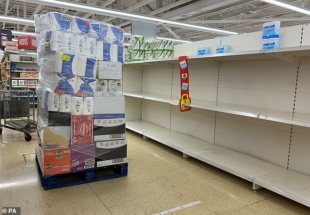 The executive director of Waitrose has slammed panic buyers saying their actions 'inevitably means someone else will go without'. Pictured: Empty shelves at a Sainsbury's in Wandsworth
