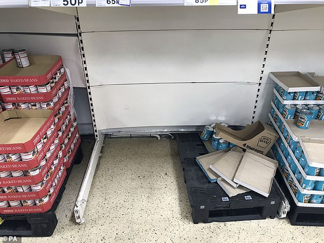 An empty space where tins of beans would normally sit at the Tesco in Slough, Berkshire