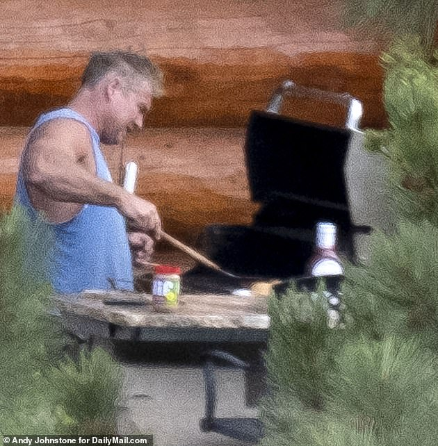 Moorman also said landscaper Barry, 52, has refused to participate in the search but did allow him access to the grounds of his $1.5 million home on Sunday. Pictured: Barry grilling out at his home in July