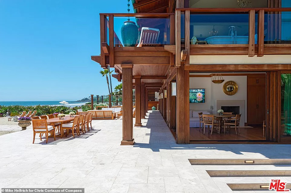 All the doors slide back to that easy access to the patio can be enjoyed together with refreshing sea breezes