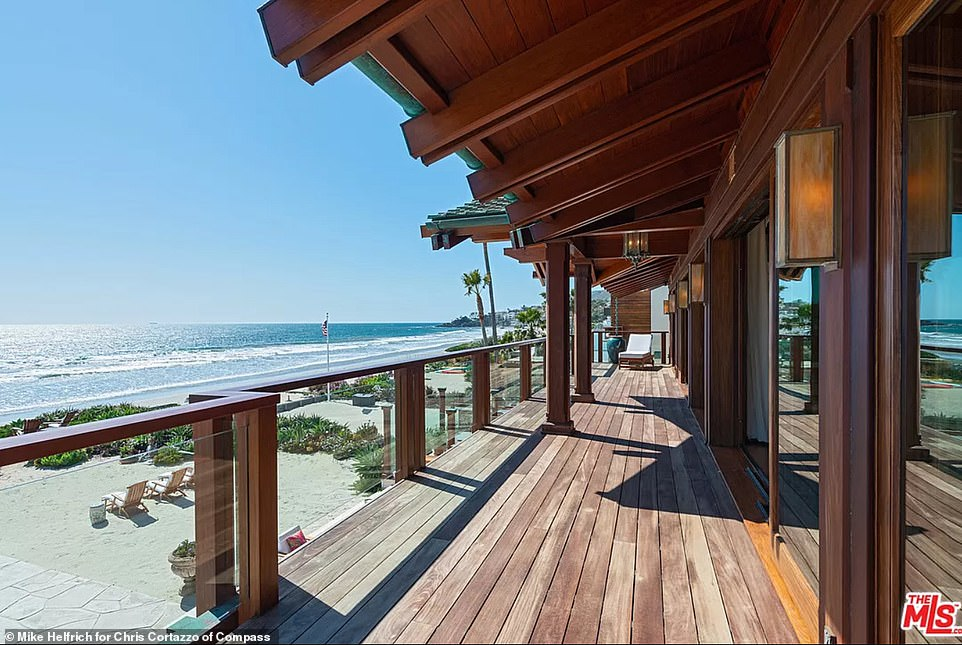 The master bedroom on the second level enjoys stunning views over the beach and a wrap around terrace