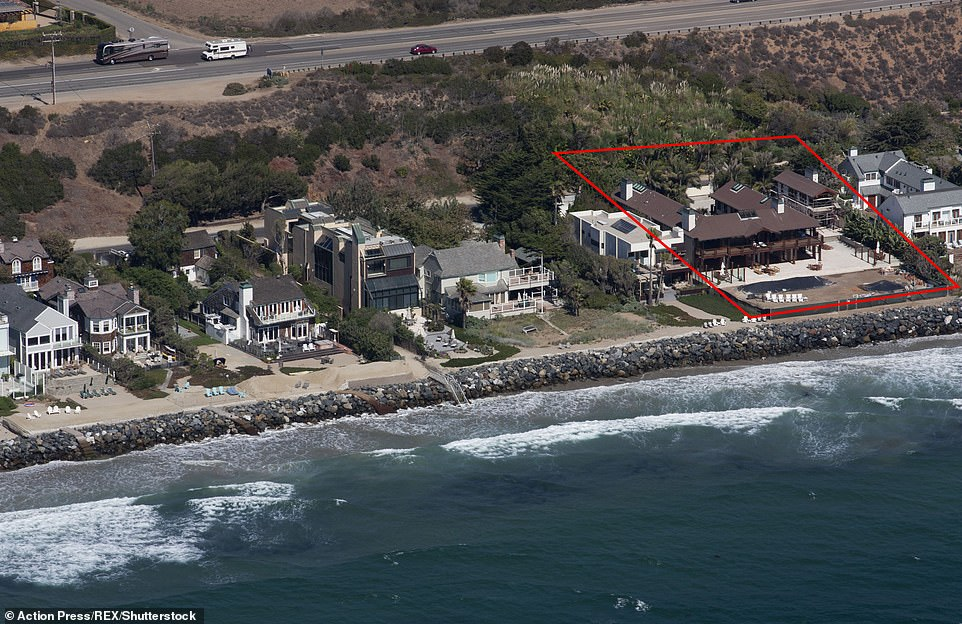 The oceanfront property, which took roughly 10 years to complete at the behest of wife, Keely, sits on more than an acre and features two homes that combine for five bedrooms and 14 bathrooms