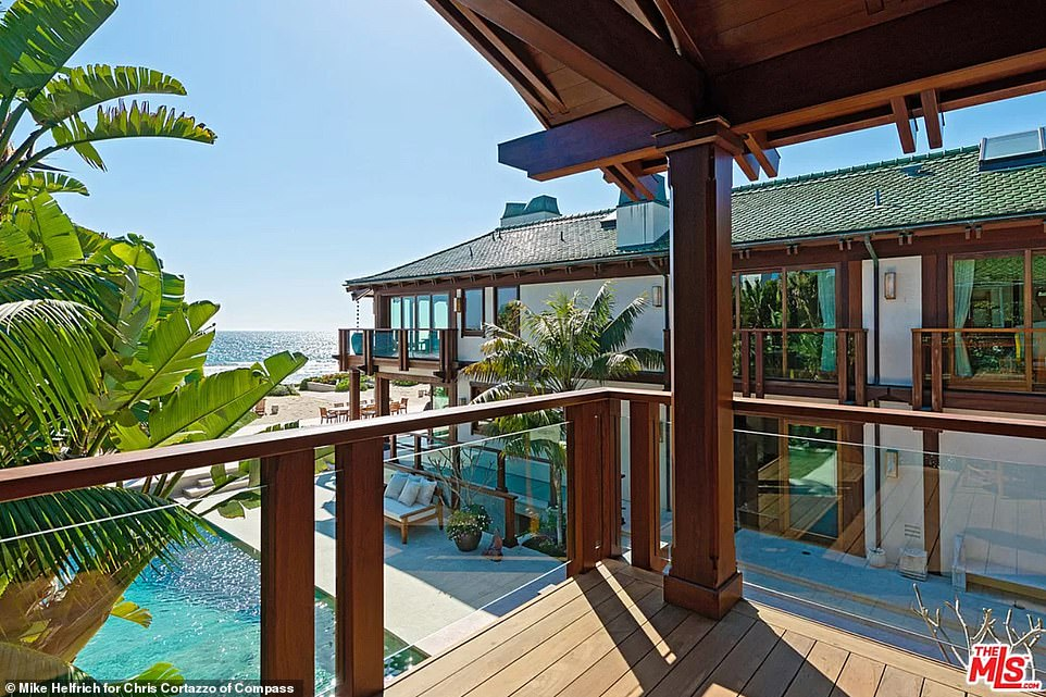The bedroom on the upper level of the home open out on to a balcony which provide sumptuous views of the ocean and pool
