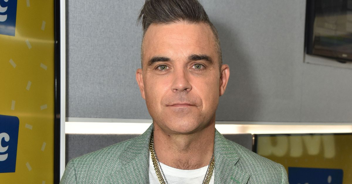 Robbie Williams confesses he pooed in his own hand while trying to secretly fart