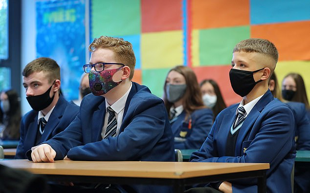 Approximately 88 per cent of state school pupils were back in class last Thursday, meaning that 12 per cent of children were marked absence (pictured: pupils from Year 11 at Hazelwood Integrated College are pictured during their first day back to the school in Belfast)