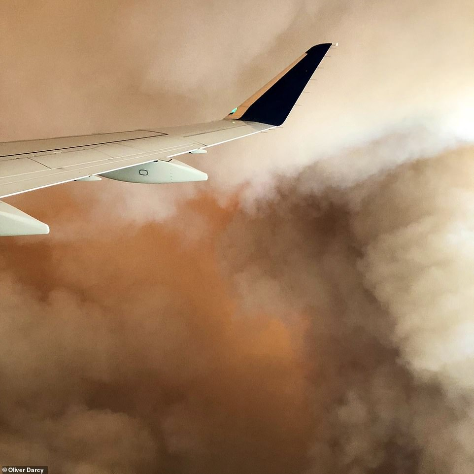 Troubling scenes were captured by family members of CNN's Oliver Darcy on Sunday evening, who were flying out from Fresno to Salt Lake City. An orange glare is seen breaking through the center of a billow of grey fumes
