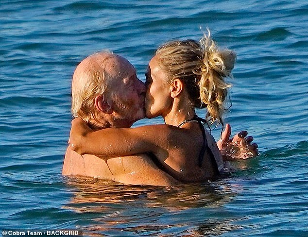 Sweet:Charles Dance, 73, shared a sweet kiss with a younger female companion, as he enjoyed a day at the beach in Venice on Thursday