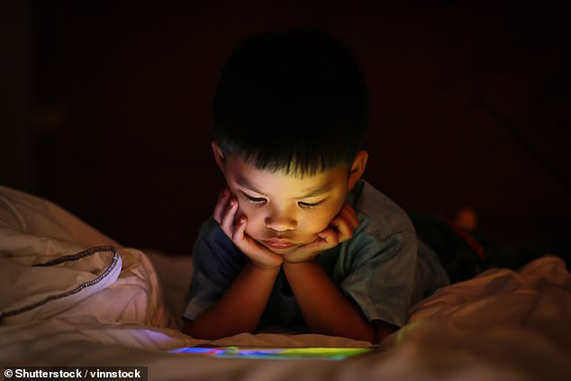 Children who get little sleep and spend too much time on their phones or tablets are most likely to be obese, research suggests (file)