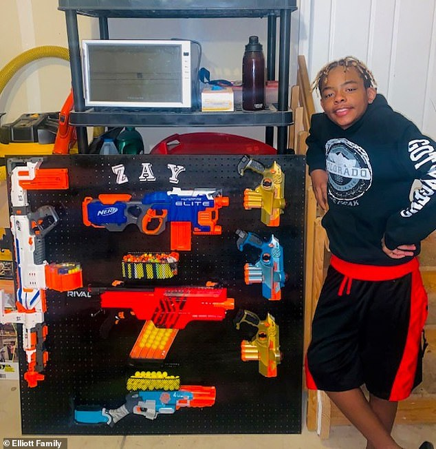 Isaiah Elliott (pictured), 12, of Colorado, was suspended and the police were called to his home after he waved a toy gun during a virtual class on August 27