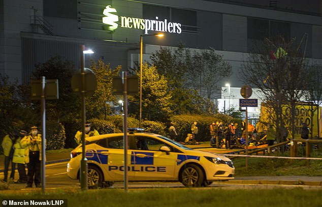Extinction Rebellion are pictured blockading Newsprinters in Broxbourne, Hertfordshire, on Friday night using vehicles and bamboo lock-ons to try to prevent newspapers from reaching newsstands on Saturday