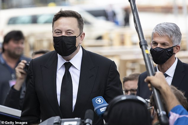 Elon Musk, technology entrepreneur, wears a mask before he attends the board meeting of a parliamentary group in Berlin, Germany today