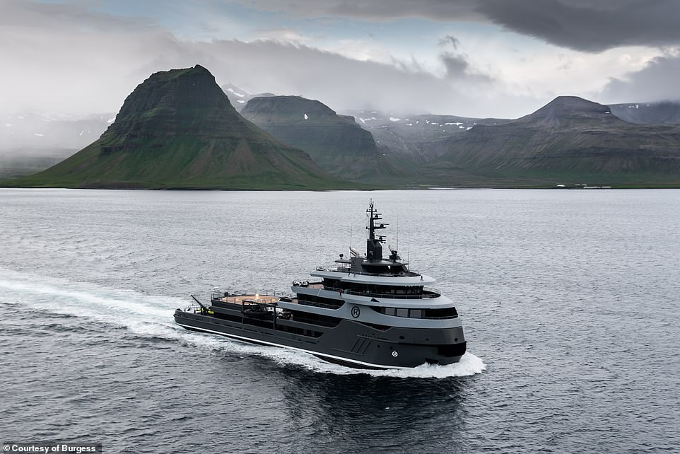 Ragnar, which underwent a 22-month makeover from an offshore supply vessel to a sleek pleasure cruiser, has hit the rental market with weekly charters starting from $525,000 (£394,046) per week. Above, the yacht pictured off Iceland