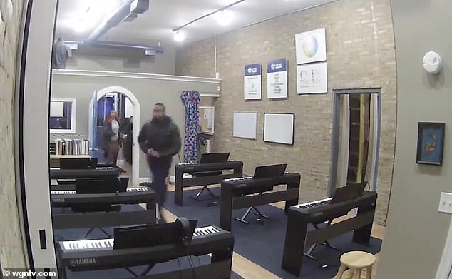 New video released this weeks shows the moment a Des Plaines, Illinois, officer pursuing a bank robbery suspect stormed into a Chicago music school and opened fire last November