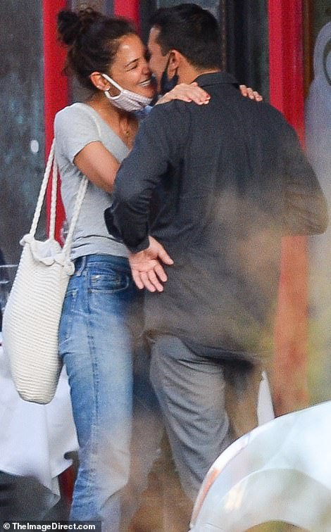 The look of love! Katie Holmes and new boyfriend Emilio Vitolo Jr. pack on some serious PDAs at his father