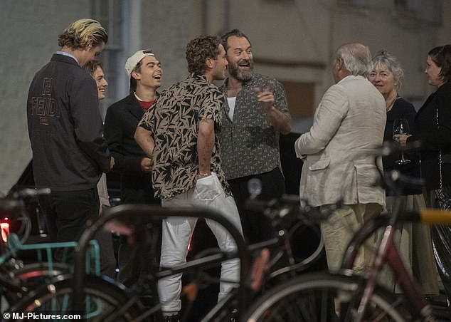 PICTURE EXCLUSIVE: Jude Law was VERY animated during family bash with wife Phillipa and ex Sadie Frost to celebrate son Rudy