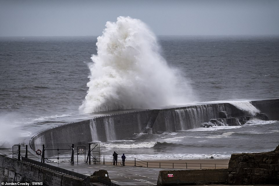 Parts of UK have coldest temperatures on record for the time of year as 40mph winds batter coast