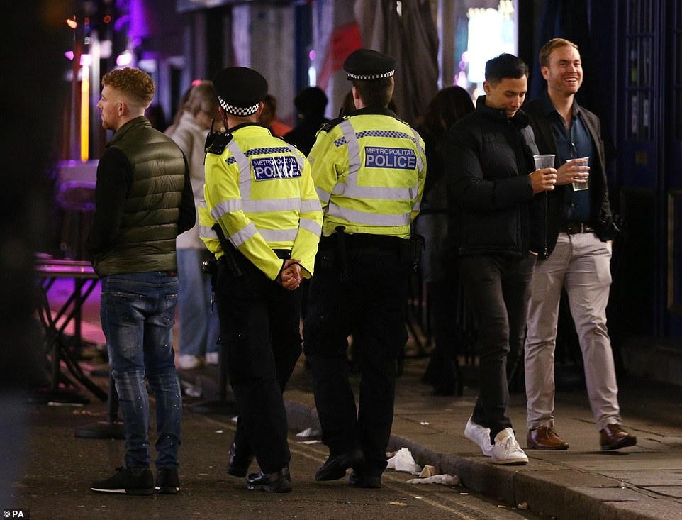 Police battle to disperse crowds partying in the street at 10pm closing time under new Covid rules