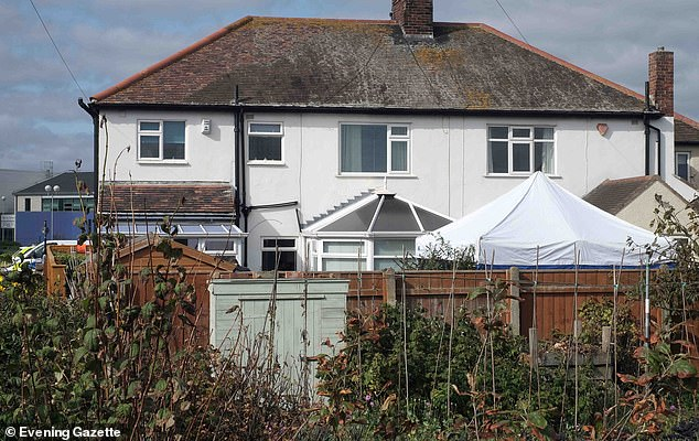 A police tent was erected in the back garden of Steven Clark