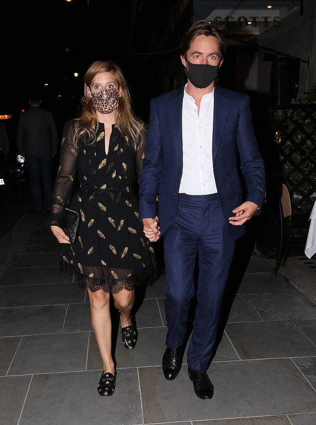 Princess Beatrice stuns in a leopard print face mask and black frock