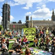Extinction Rebellion protesters sitting outside The Houses of Parliament in Parliament Square, Westminster, London, September 1