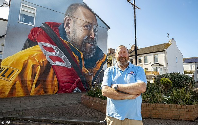 Royal National Lifeboat Institution volunteer Mike Jones, 58, was honouredwith a giant mural to mark 40 years of rescues