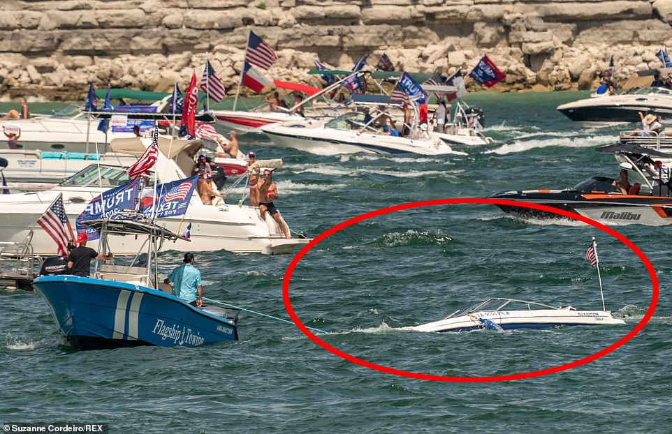 One of the five boats that sank in the reservoir in Lake Travis, Texas, on Saturday during a a Trump boat parade has been recovered
