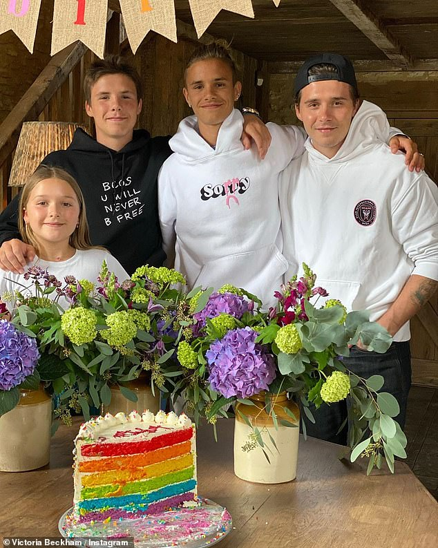 Celebrations: Romeo Beckham enjoyed a rainbow cake with his siblings in a sweet snap shared by mum Victoria on Tuesday, as they celebrated his 18th birthday with a low-key party