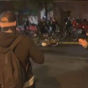 Shocking moment Seattle cop pushes a bike over the head of a protester amid Breonna Taylor rally
