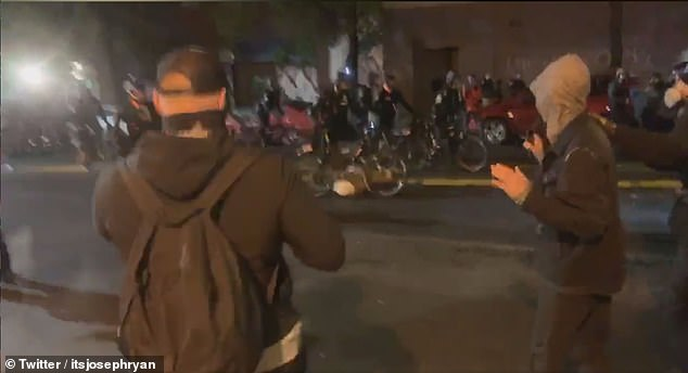 Cellphone footage captured the moment a cop in Seattle pushes his bike over the head of a protester during demonstrations in the city