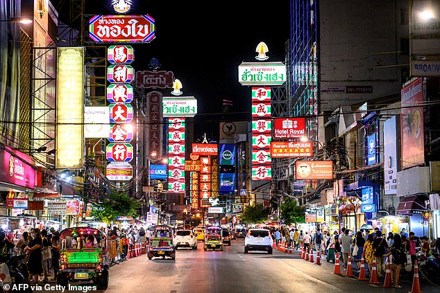 Travellers returning from Thailand and Singapore will no longer have to quarantine after they were added to the UK safe travel list tonight. Pictured is Bangkok