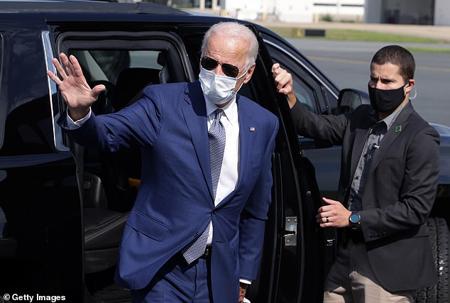 Joe Biden waves to reporters as he arrives at the New Castle, Delaware airport en route to Kenosha, Wisconsin where he plans to meet with Jacob Blake